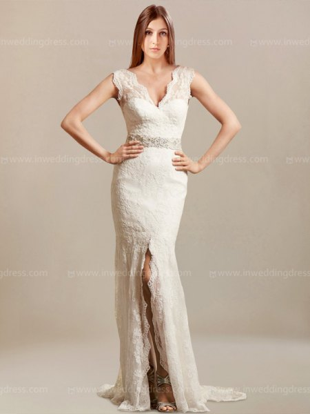 white fit with scalloped neckline and floor-length, highly split, flowing dress