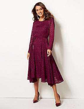 purple long sleeve lace flared dress with black velvet heels