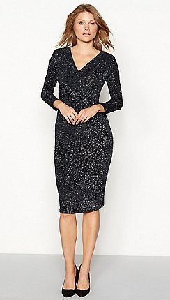 dark purple and white midi dress with polka dots and V-neck and black heels