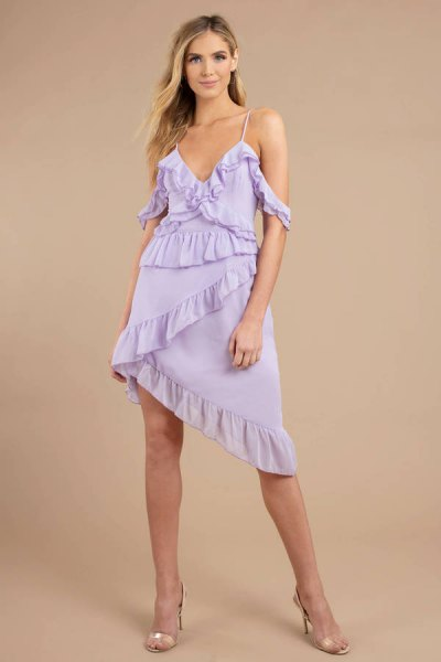 Light purple, asymmetrical slip dress with frills and pink heels