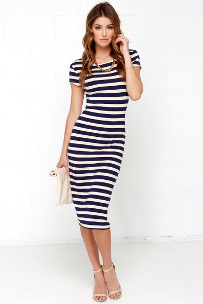 Dark blue and white striped body-hugging midi dress with pink heels and open toes