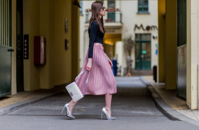 black long-sleeved t-shirt with pink pleated midi skirt