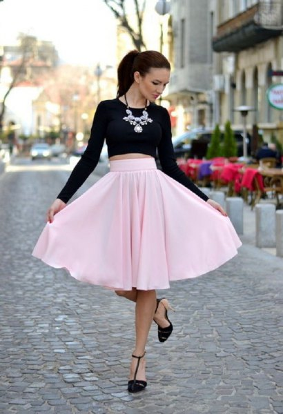 black, short-cut long-sleeved T-shirt with light pink midi skirt