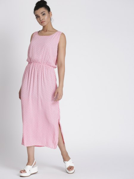 Light pink sleeveless maxi dress with a gathered waist and white sandals