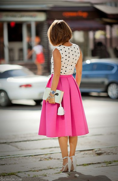 sleeveless blouse with white and black polka dots and pink pleated midi skirt