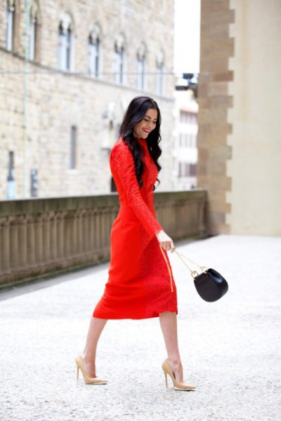 red long-sleeved midi shift dress with pink high heels with pointed toes