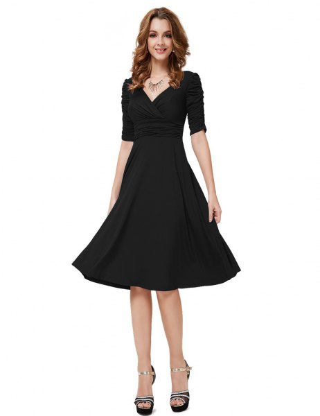 Black, half-sleeved V-neck fit and knee-length cocktail dress with flap
