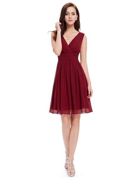 red cocktail dress with V-neck and silver strappy high heels