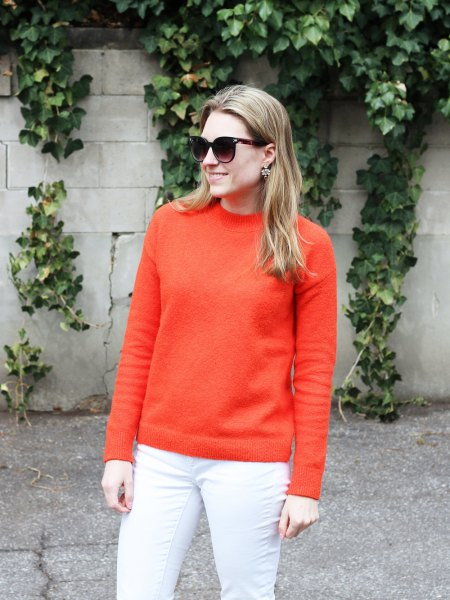 orange, chunky cotton sweater with white skinny jeans