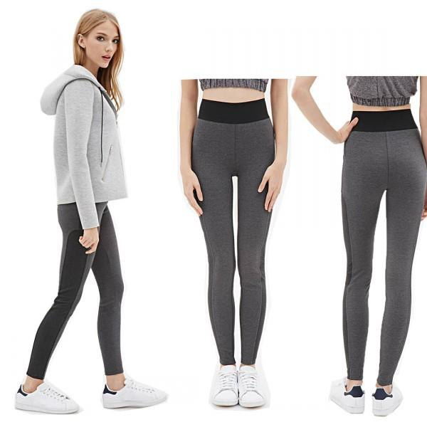 Light gray hoodie with dark running gaiters and white sneakers