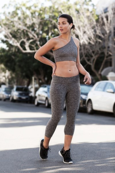gray crop top with matching training gaiters and black running shoes