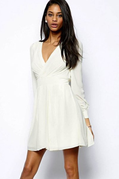white wrap dress with V-neck and flared mini dress