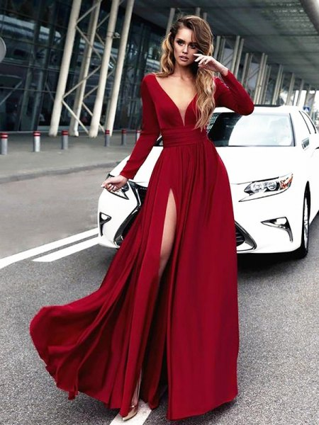 red maxi dress with deep V-neck and long sleeves and high slit