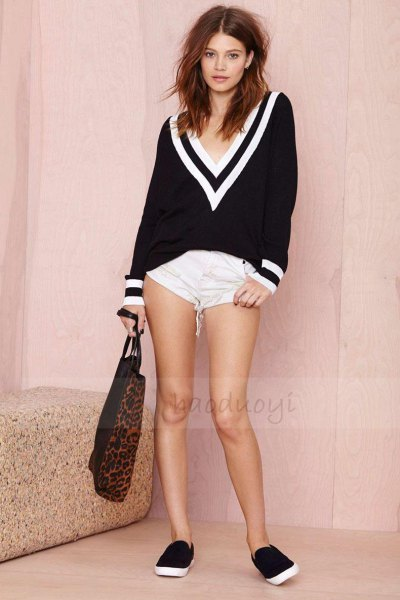 Black and white sweater with a large V-neck and super mini shorts