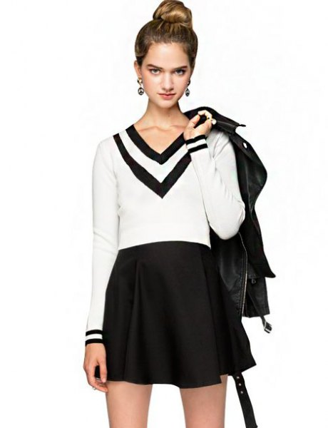 white and black sweater with V-neck and high waisted mini-skirt