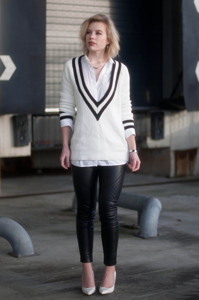 white and black sweater with v-neck, shirt with buttons and leather gaiters