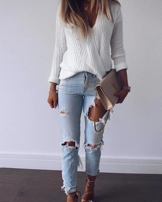 white, oversized sweater with V-neck and blue ribbed slim fit jeans