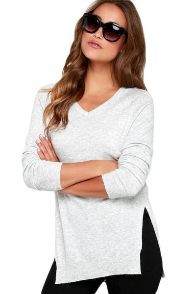 white side slit sweater with black skinny jeans with high waist