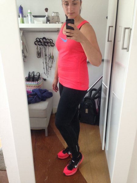 pink tank top with black running gaiters and sneakers