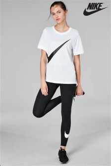 white oversized t-shirt with black Nike running pants