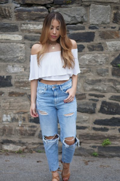 white, off-shoulder, short-cut blouse with torn mom jeans