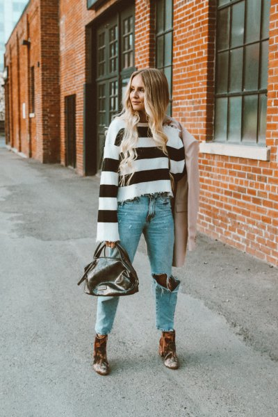 wide striped black and white sweater with ankle boots