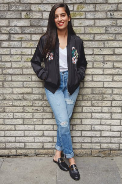 black floral bomber jacket with white V-neck t-shirt and loafers