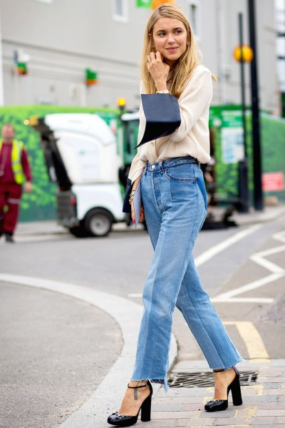 white sweater with a relaxed fit and blue mom jeans