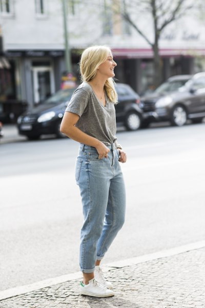 gray V-neck t-shirt and light blue jeans with cuffs