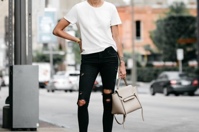 white t-shirt with black skinny jeans and light pink leather handbag