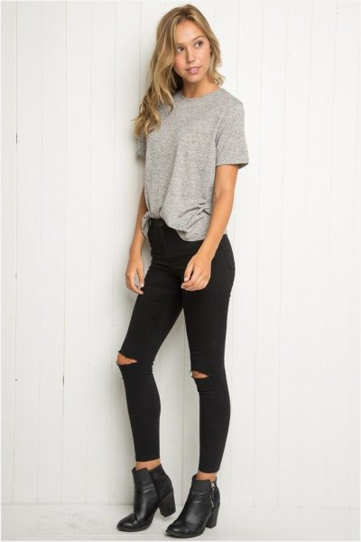 gray, partly hidden, oversized t-shirt with black, high-rise skinny jeans