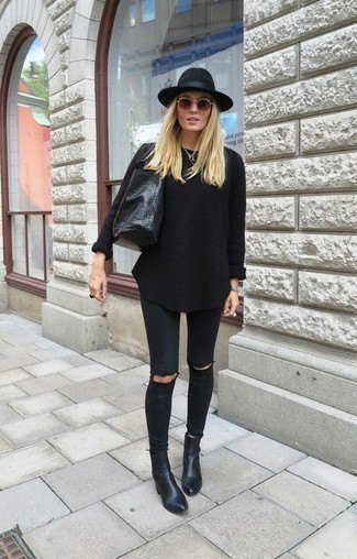 black knitted sweater with matching jeans and leather ankle boots