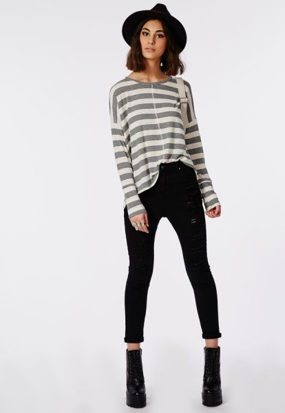 gray and white striped long-sleeved T-shirt with high waisted black skinny jeans with cuffs