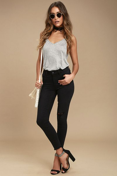gray tank top with a deep v-neck and black skinny jeans with a high waist