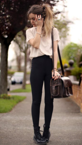white t-shirt with black skinny jeans and combat boots