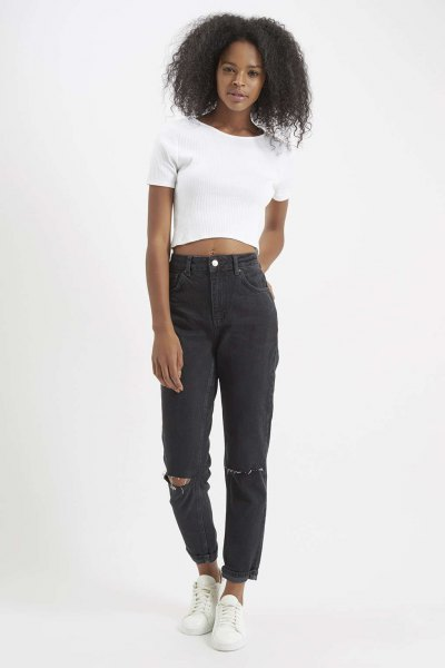 white short t-shirt with black torn mom jeans