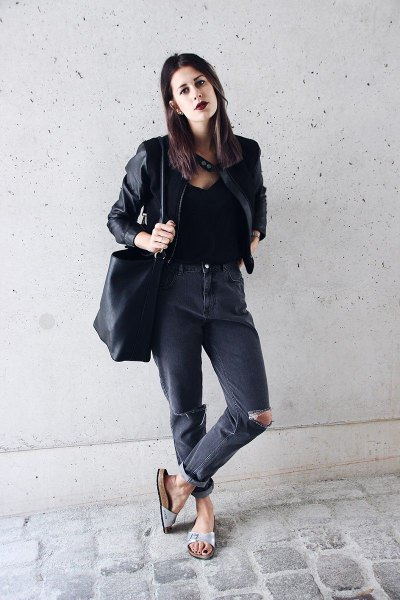 black leather jacket with torn jeans and slide sandals