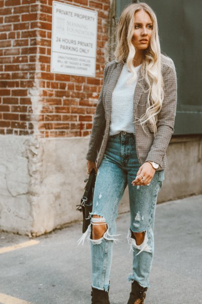 Tweed blazer with torn mom jeans and black boots