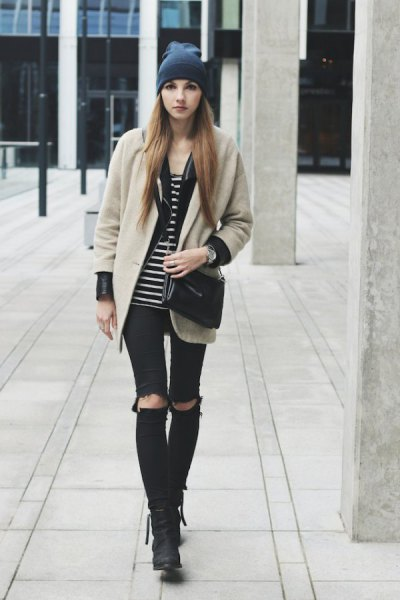 Blushing pink wool coat with black and white striped tank top and torn knee jeans