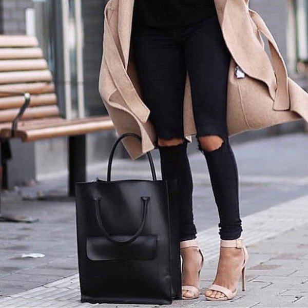 Blushing pink wool coat with black, torn jeans