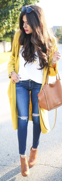 yellow longline cardigan sweater with white blouse and torn knee jeans