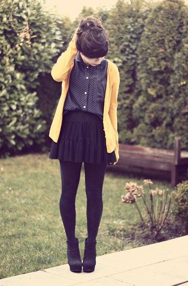 Cardigan with black polka dot shirt and mini pleated skirt