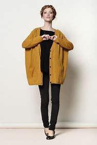 dark mustard yellow, chunky knit sweater with black t-shirt