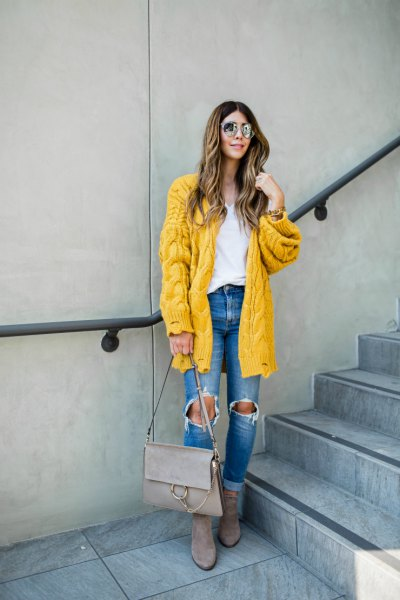 Cable pattern lemon yellow cardigan with blue destroyed jeans