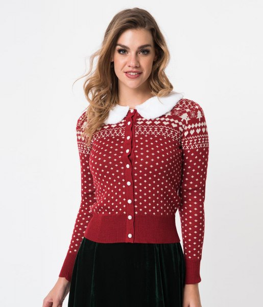 red and white Christmas cardigan with button and black skirt