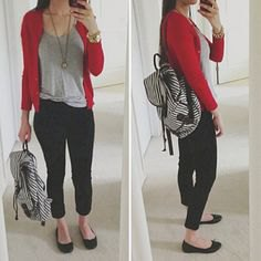 red sweater with gray t-shirt with a scoop neck and black, short jeans
