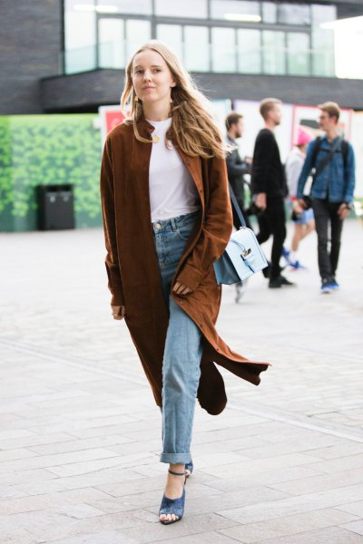 burgundy-colored longline cardigan with a white crew-neck t-shirt and jeans with cuffs