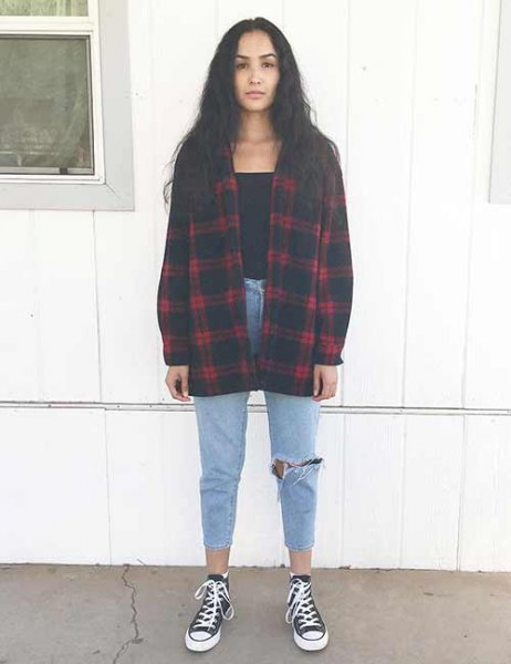 red and black oversized checkered flannel shirt with canvas sneakers