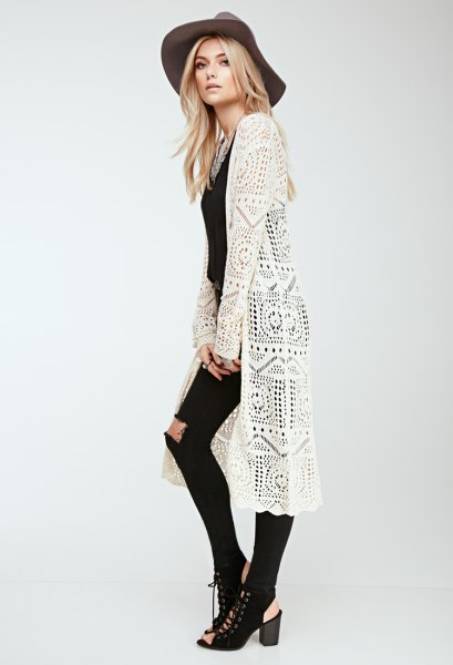 white long crochet cradigan with black skinny jeans