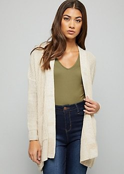 white cardigan with green V-neck t-shirt and high waisted blue jeans